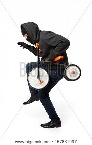 Burglar sneaking small child bike