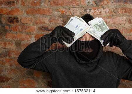 Burglar standing in black mask