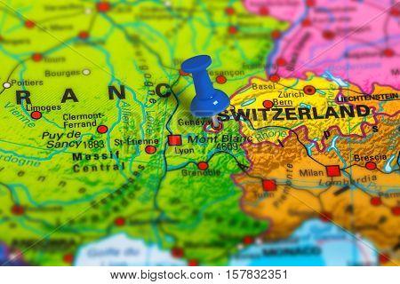 Geneva in Switzerland pinned on colorful political map of Europe. Geopolitical school atlas. Tilt shift effect.