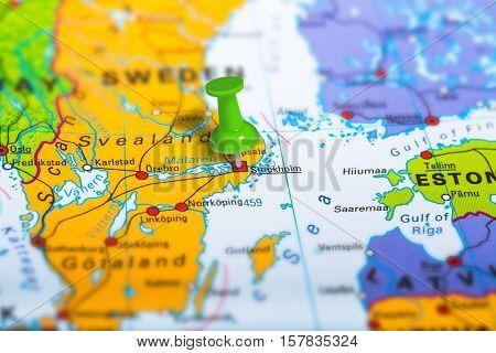 Stockholm in Sweden pinned on colorful political map of Europe. Geopolitical school atlas. Tilt shift effect.