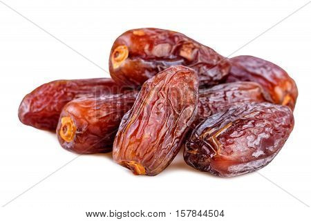 heap of dried dates on white background