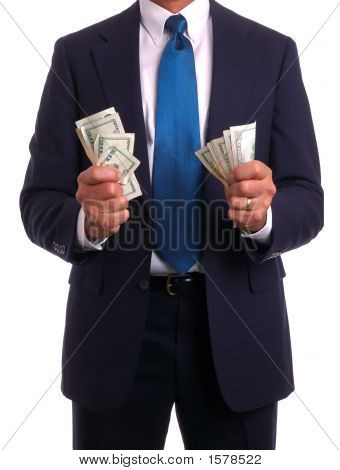 Businessman In Suit Holding Money