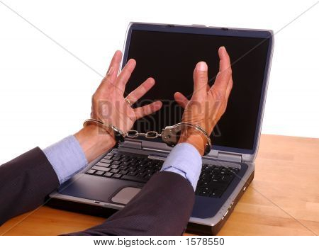 Hands Cuffed Grabbing Computer Screen