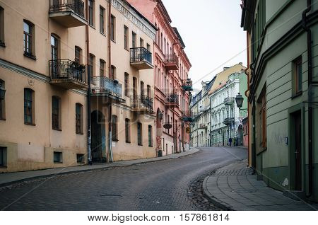 Vilnius Lithuania - November 11 2016: Main street Uzupio gatve in Uzupis a bohemian and artistic district in Vilnius Lithuania.