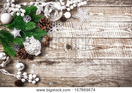 Christmas holiday decoration with pinecone balls. Holidays greeting card, old wooden board rustic style, copyspace and top view.
