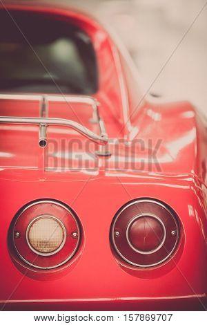 Close up shot of a vintage car rear lights.