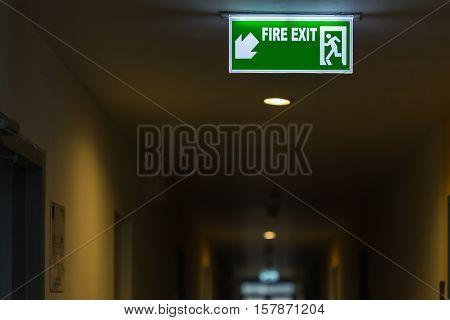 Fire Exit Sign In Hotel Corridor