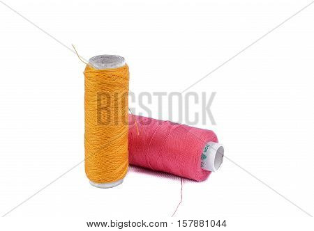 Sewing thread and needle on white. Threads for sewing