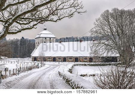 View of a snow covered Hovdala Castle in Hassleholm region. Hovdala Castle is a castle in Hassleholm Municipality Scania in southern Sweden.