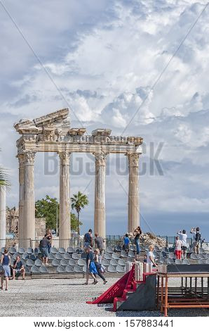 SIDE TURKEY - OCTOBER 02 2013: Tourists sightseeing at the ancient ruins of the temple of Apollo in Side.
