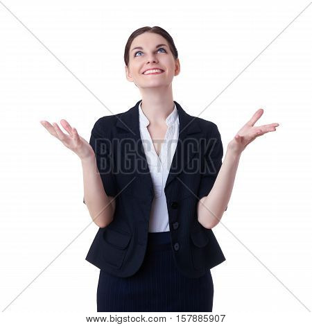Smiling businesswoman standing over white isolated background catching something from above, business, education, office concept