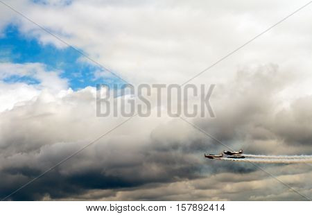 Planes in the cloudy sky transportation concept