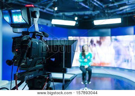 Closeup of a Video Camera Filming a TV Host
