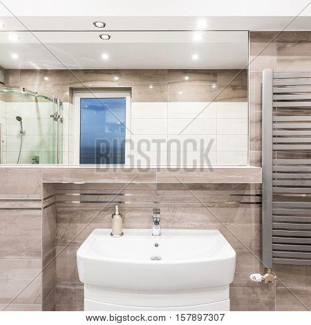 Beige Bathroom With Heater