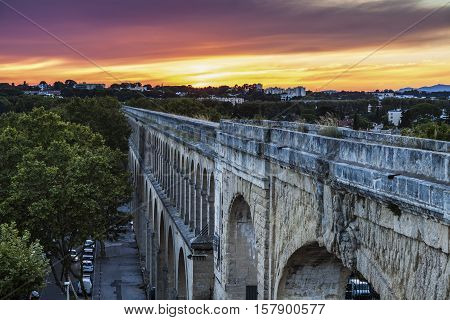 Saint Clement Aqueduct in Montpellier at sunset. Montpellier Occitanie France.