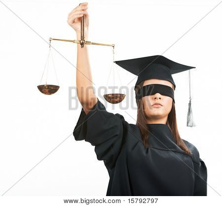 Young lawyer with closed eyes holding scales
