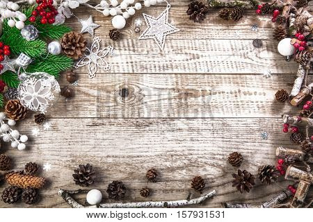 Christmas holiday background with pinecone balls. Holiday greeting card branch old wooden board rustic style, copyspace and top view