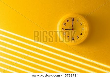 Yellow wall & clock