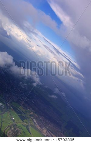 Aerial of earth view with dramatic clouds and blue sky