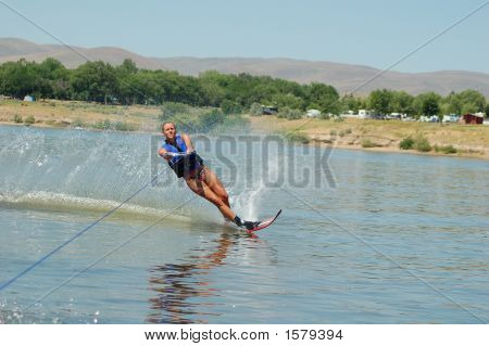 Beautiful Woman Waterskiing On A Calm Lake
