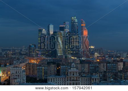 MOSCOW - JUN 11, 2016: Futuristic Moscow International Business Center under construction at night. East tower of complex Federation in height 374 m - highest skyscraper in Europe