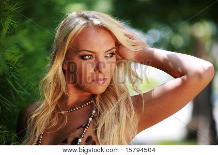Portrait of a beautiful blond woman outdoors. Close-up, shallow DOF.