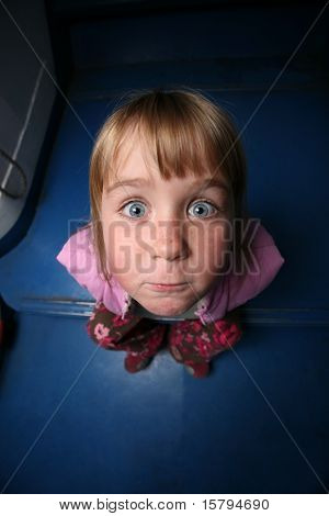 Fun little girl, wide angle view from above