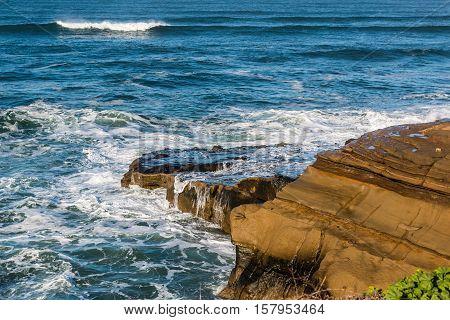 Ocean waves and rock formations at Sunset Cliffs in San Diego, California.