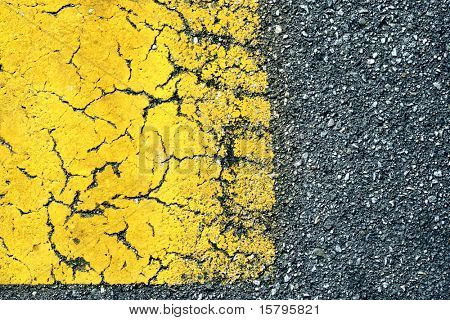 Abstract background: old paint on asphalt road, macro detail