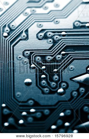 Circuit board abstract background texture. Macro close-up, shallow DOF.