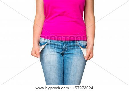 Young woman pulling out empty pockets isolated on white background