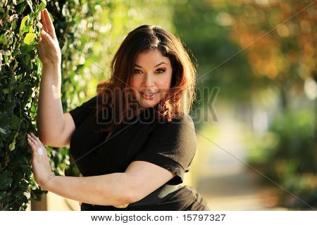 Beautiful plus size model outdoors. Shallow DOF.