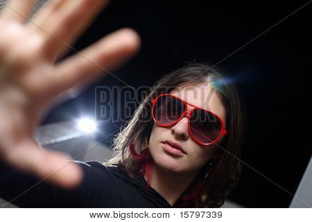 Young woman playing rockstar personality