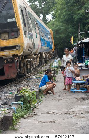 Bangkok , Thailand - july 26, 2005:  Many families live along the railroad tracks or in slums. There are an estimated 7.3 million people that are considered to be in poverty in Bangkok, Thailand.