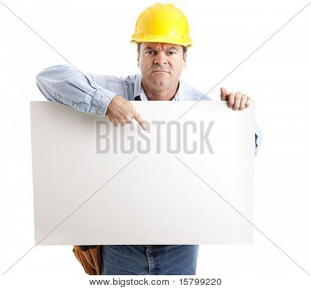 Angry construction worker points to a blank sign, ready for your text.  Isolated on white.