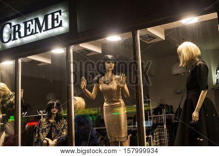 POLAND ZAKOPANE - JANUARY 03 2015: Boutique fashion mannequins in window of shop exhibition in Zakopane.
