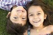 image of brother sister  - Brother and sister playing outside - JPG