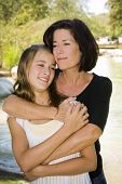 foto of mother daughter  - Mother and daughter outdoors on a Spring day - JPG