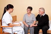 stock photo of pity  - Care of relatives of a patient by a psychologist - JPG