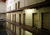stock photo of infraction law  - Interior view of floors of prison cell blocks - JPG