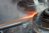 pic of factory-worker  - machine for welding steel pipes in a factory - JPG