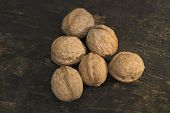 Постер, плакат: Walnuts Walnuts Close up Walnuts On A Dark Background Walnuts On A Wooden Table Walnuts On A Dar