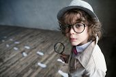Little detective with a magnifying glass poster