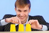 stock photo of deuce  - businessman plays bad financial business  - JPG