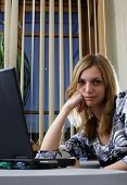 picture of blinders  - Young woman in office - JPG