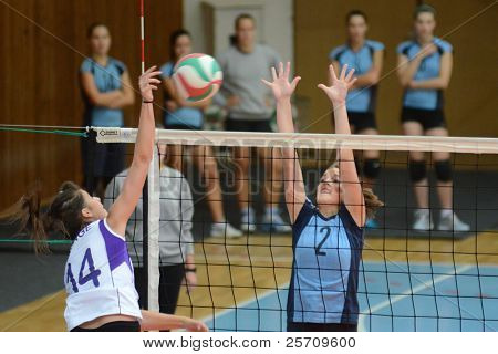 KAPOSVAR, HUNGARY - OCTOBER 16: Zsanett Pinter (blue 2) in action at the Hungarian NB I. League woman volleyball game Kaposvar (blue) vs Ujpest (white), October 16, 2011 in Kaposvar, Hungary.