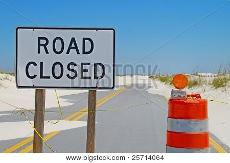 Washed out road with closed sign