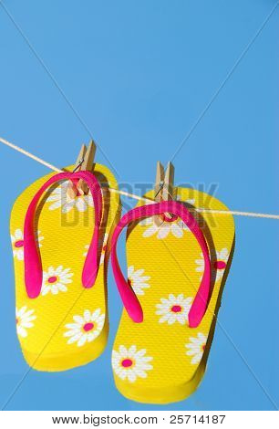 Yellow Sandals On Clothes Line
