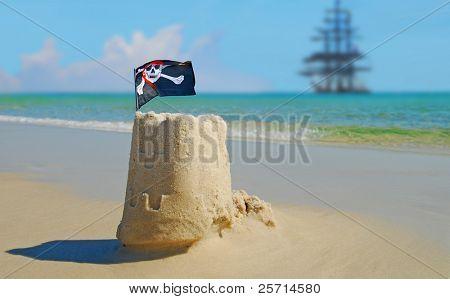 Pirate Sand Castle with Pirate Ship in Distance