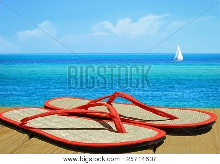 Straw Flip Flops on Dock with Sailboat in Distance